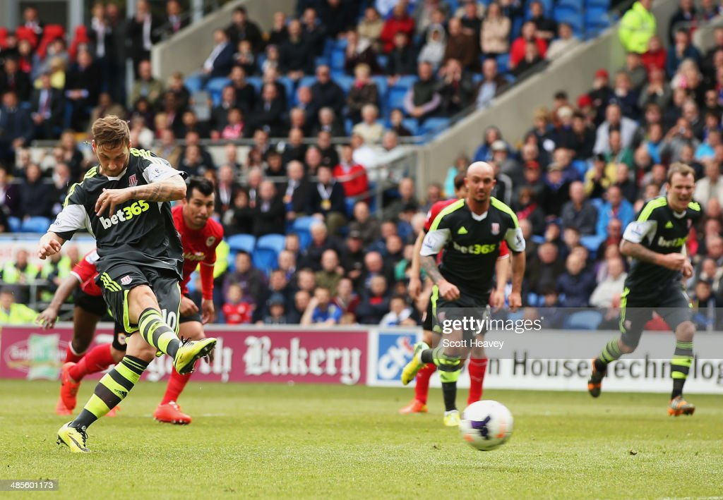 Marko Arnautovic of Stoke City scores their first goal from a penalty spot during the Barclays Premier League match between Cardiff City and Stoke City at Cardiff City Stadium on April 19, 2014 in Cardiff, Wales.