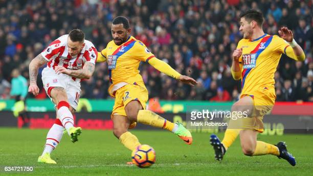 Marko Arnautovic of Stoke City shoots while Jason Puncheon and James Tomkins of Crystal Palace try to block during the Premier League match between...