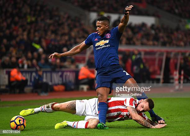 Marko Arnautovic of Stoke City tackles Antonio Valencia of Manchester United during the Premier League match between Stoke City and Manchester United...
