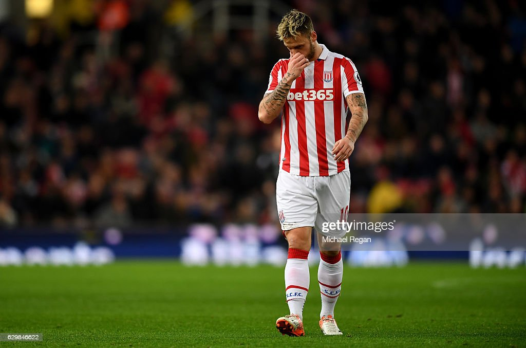 Marko Arnautovic of Stoke City walks off the pitch after shown the red card during the Premier League match between Stoke City and Southampton at Bet365 Stadium on December 14, 2016 in Stoke on Trent, England.