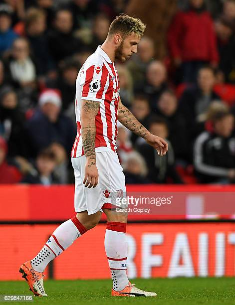 Marko Arnautovic of Stoke City walks off the pitch after shown the red card during the Premier League match between Stoke City and Southampton at...