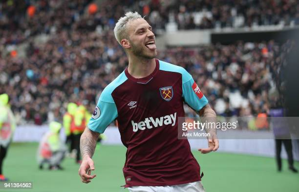 Marko Arnautovic of West Ham celebrates after scoring their second goal during the Premier League match between West Ham United and Southampton at...