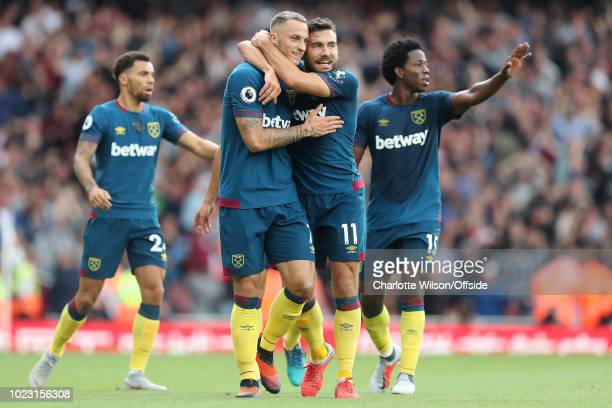 Marko Arnautovic of West Ham celebrates scoring the opening goal with Robert Snodgrass during the Premier League match between Arsenal FC and West...