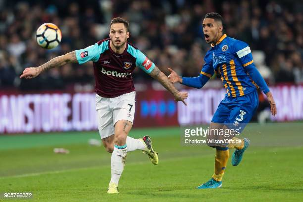 Marko Arnautovic of West Ham in action with Max Lowe of Shrewsbury Town during the Emirates FA Cup Third Round Replay match between West Ham United...