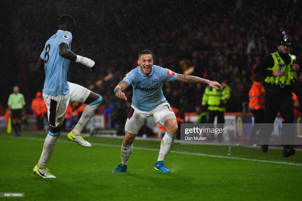 Marko Arnautovic of West Ham United and Cheikhou Kouyate of West Ham United celebrates after Marko Arnautovic scored their sides third goal during the Premier League match between AFC Bournemouth and West Ham United at Vitality Stadium on December 26, 2017 in Bournemouth, England.
