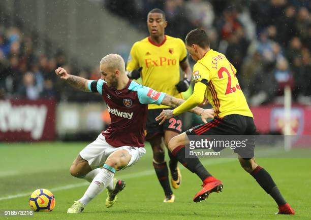 Marko Arnautovic of West Ham United and Jose Holebas of Watford battle for the ball during the Premier League match between West Ham United and...