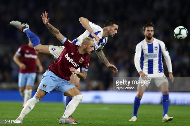 Marko Arnautovic of West Ham United and Shane Duffy of Brighton and Hove Albion in action during the Premier League match between Brighton Hove...