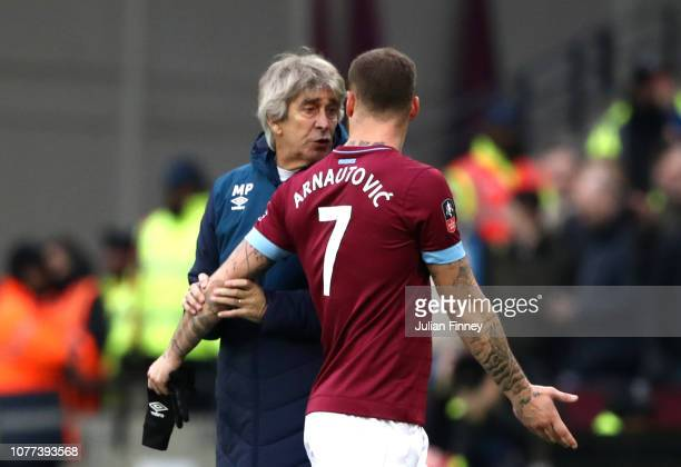 Marko Arnautovic of West Ham United argues with Manuel Pellegrini Manager of West Ham United after being substitute during the FA Cup Third Round...