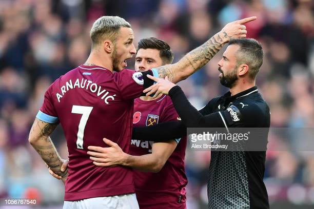 Marko Arnautovic of West Ham United argues with Steven Defour of Burnley during the Premier League match between West Ham United and Burnley FC at...