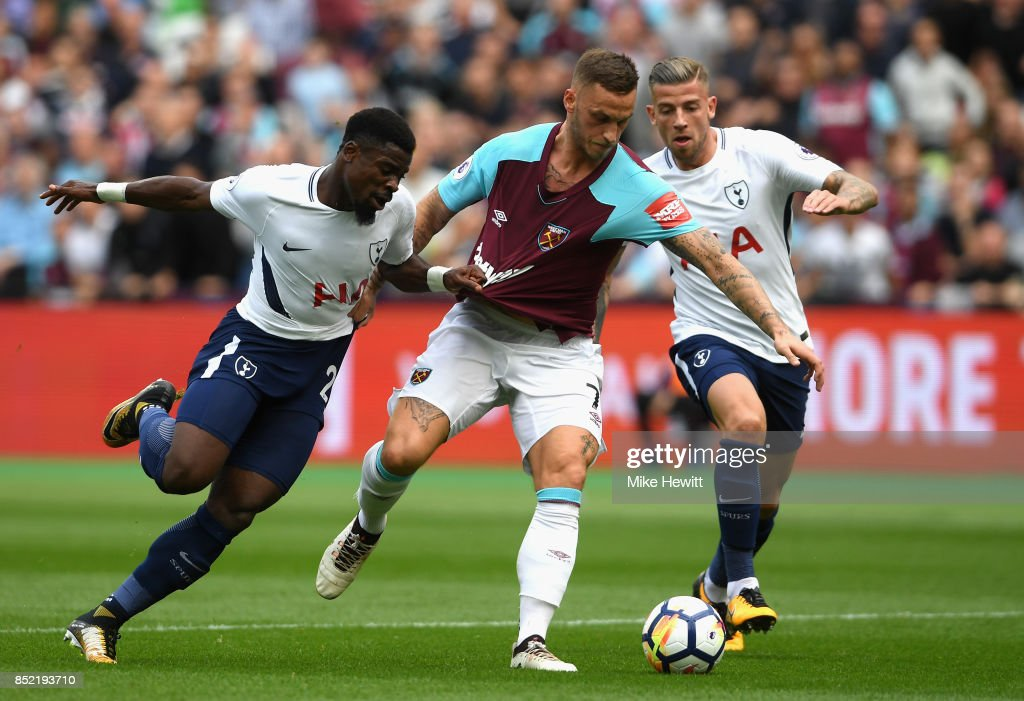 Marko Arnautovic of West Ham United attempts to get past Serge Aurier of Tottenham Hotspur and Toby Alderweireld of Tottenham Hotspur during the Premier League match between West Ham United and Tottenham Hotspur at London Stadium on September 23, 2017 in London, England.
