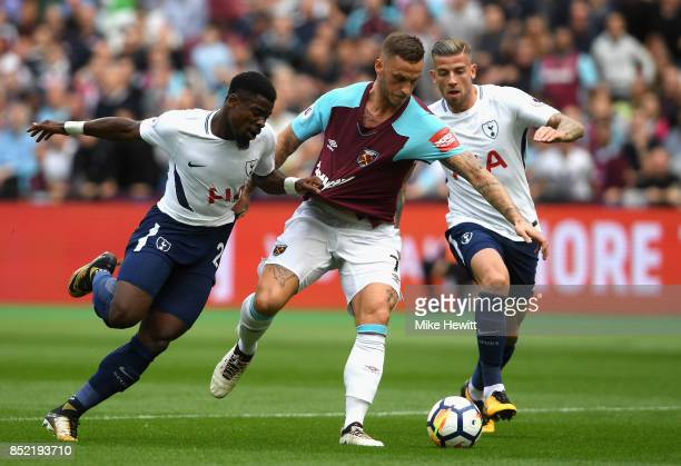 Marko Arnautovic of West Ham United attempts to get past Serge Aurier of Tottenham Hotspur and Toby Alderweireld of Tottenham Hotspur during the...