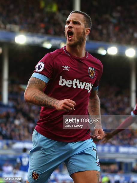 Marko Arnautovic of West Ham United celebrates after scoring his team's third goal during the Premier League match between Everton FC and West Ham...