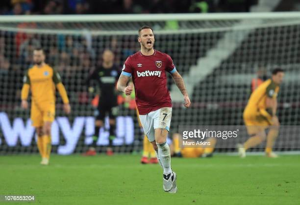 Marko Arnautovic of West Ham United celebrates after scoring his team's second goal during the Premier League match between West Ham United and...