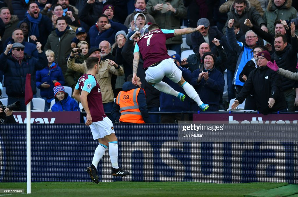 Marko Arnautovic of West Ham United celebrates after scoring his sides first goal during the Premier League match between West Ham United and Chelsea at London Stadium on December 9, 2017 in London, England.