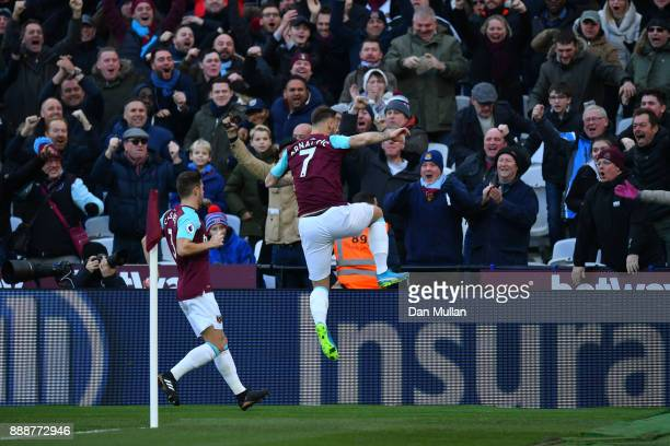 Marko Arnautovic of West Ham United celebrates after scoring his sides first goal during the Premier League match between West Ham United and Chelsea...