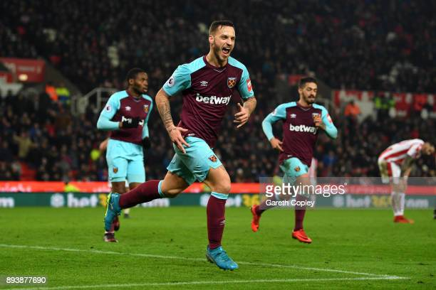 Marko Arnautovic of West Ham United celebrates after scoring his sides second goal during the Premier League match between Stoke City and West Ham...