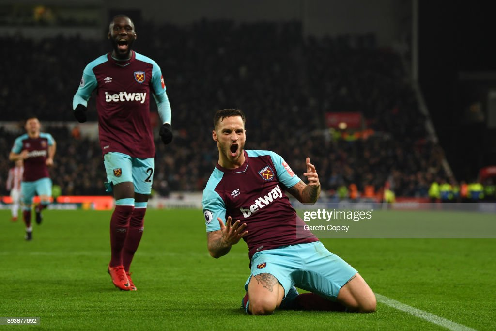 Marko Arnautovic of West Ham United celebrates after scoring his sides second goal during the Premier League match between Stoke City and West Ham United at Bet365 Stadium on December 16, 2017 in Stoke on Trent, England.