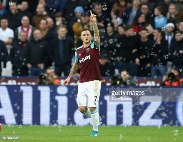 Marko Arnautovic of West Ham United celebrates after scoring his sides first goal during the Premier League match between West Ham United and...