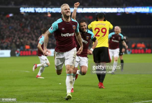Marko Arnautovic of West Ham United celebrates after scoring his sides second goal during the Premier League match between West Ham United and...