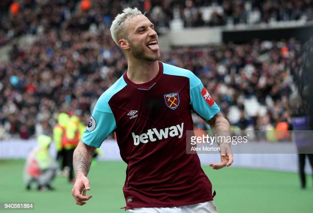 Marko Arnautovic of West Ham United celebrates after scoring his sides third goal during the Premier League match between West Ham United and...