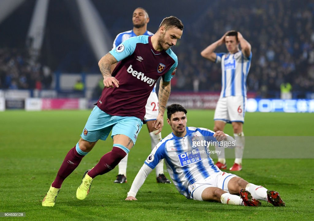 Marko Arnautovic of West Ham United celebrates as he scores their second goal during the Premier League match between Huddersfield Town and West Ham United at John Smith's Stadium on January 13, 2018 in Huddersfield, England.