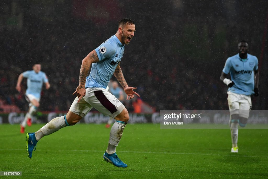 Marko Arnautovic of West Ham United celebrates scoring his sides third goal during the Premier League match between AFC Bournemouth and West Ham United at Vitality Stadium on December 26, 2017 in Bournemouth, England.