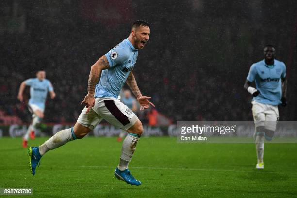 Marko Arnautovic of West Ham United celebrates scoring his sides third goal during the Premier League match between AFC Bournemouth and West Ham...