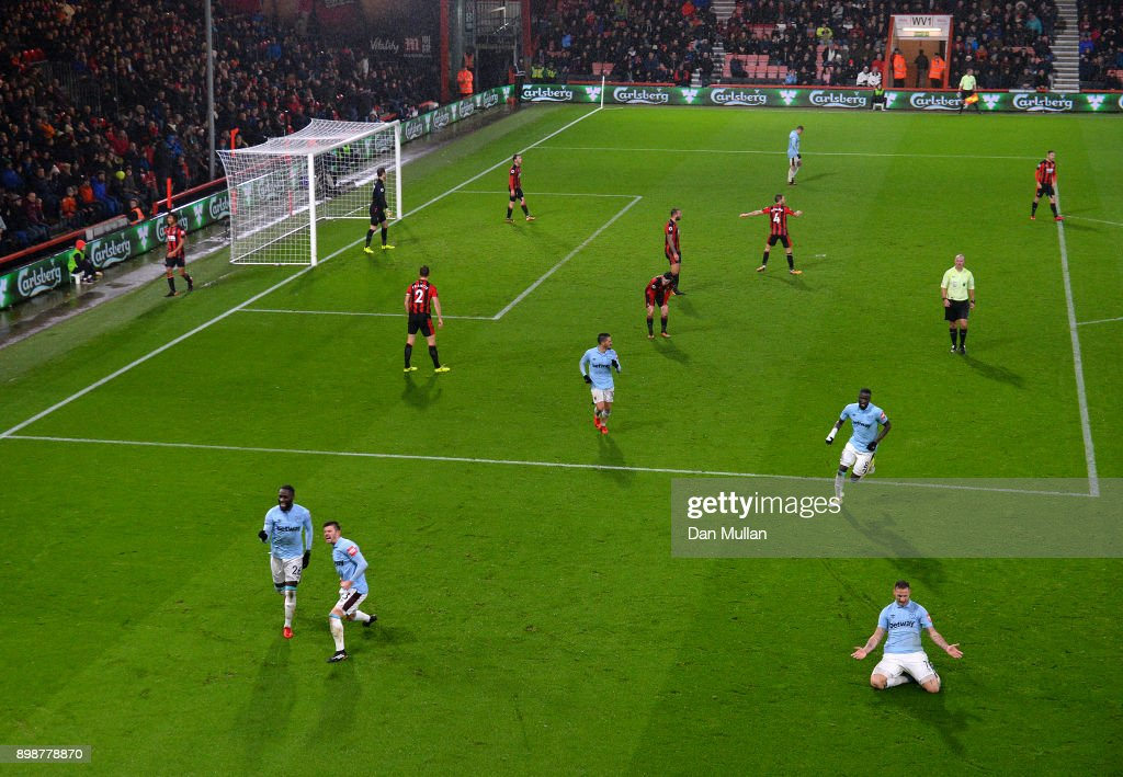 Marko Arnautovic of West Ham United (bottom right) celebrates scoring his sides third goal during the Premier League match between AFC Bournemouth and West Ham United at Vitality Stadium on December 26, 2017 in Bournemouth, England.