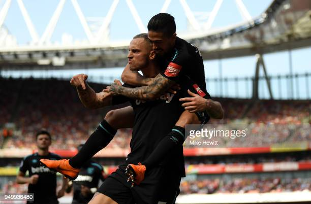 Marko Arnautovic of West Ham United celebrates scoring his side's first goal with Manuel Lanzini during the Premier League match between Arsenal and...