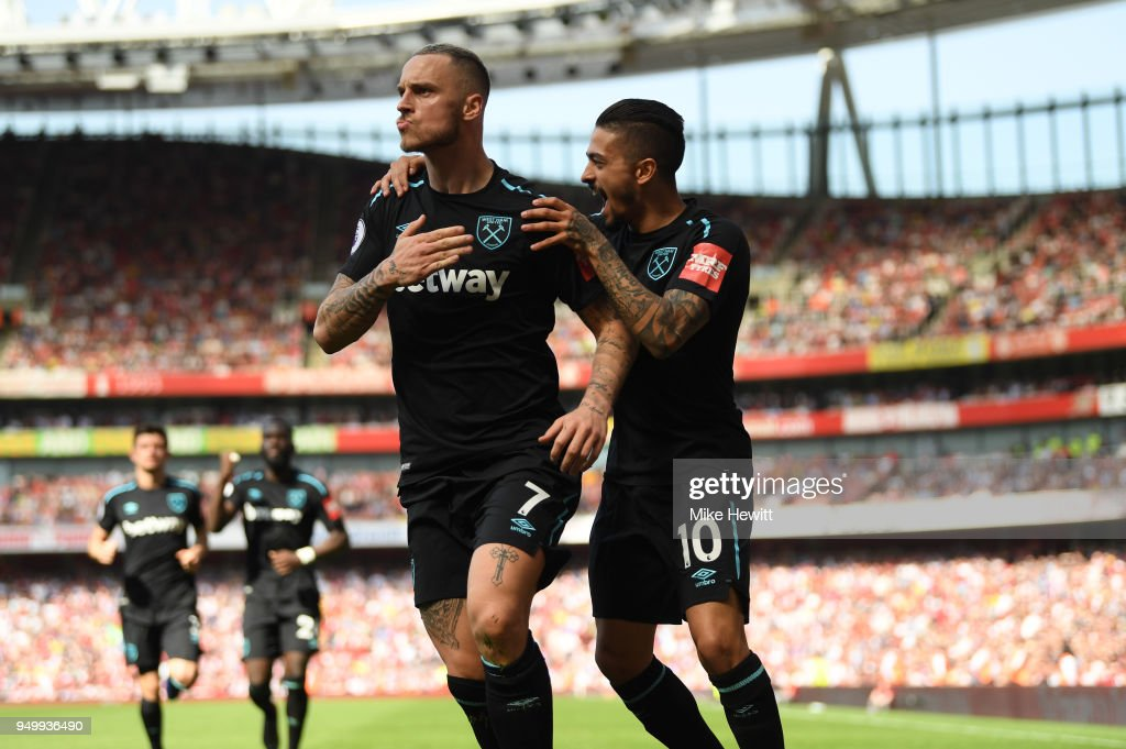Marko Arnautovic of West Ham United celebrates scoring his side's first goal with Manuel Lanzini during the Premier League match between Arsenal and West Ham United at Emirates Stadium on April 22, 2018 in London, England.