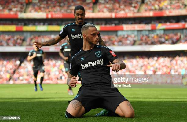 Marko Arnautovic of West Ham United celebrates scoring his side's first goal during the Premier League match between Arsenal and West Ham United at...
