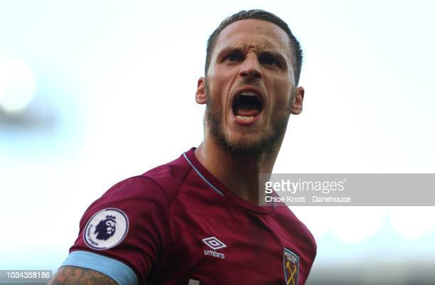 Marko Arnautovic of West Ham United celebrates scoring his teams 3rd goal during the Premier League match between Everton FC and West Ham United at...