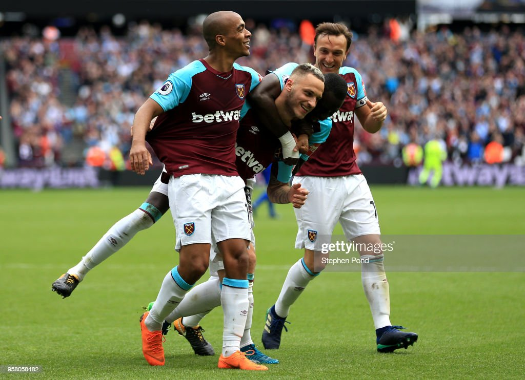 Marko Arnautovic of West Ham United (center) celebrates with Joao Mario of West Ham aUnited nd Mark Noble of West Ham United after scoring his sides second goal during the Premier League match between West Ham United and Everton at London Stadium on May 13, 2018 in London, England.