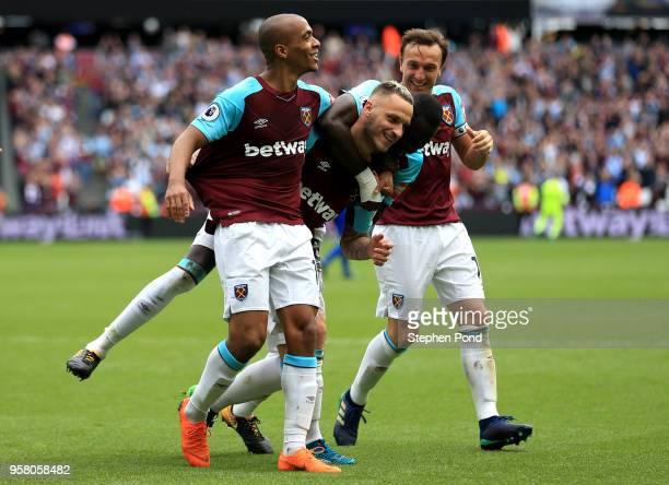 Marko Arnautovic of West Ham United celebrates with Joao Mario of West Ham aUnited nd Mark Noble of West Ham United after scoring his sides second...