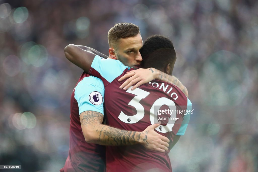 Marko Arnautovic of West Ham United celebrates with Michail Antonio after scoring his sides first goal during the Premier League match between West Ham United and Newcastle United at London Stadium on December 23, 2017 in London, England.