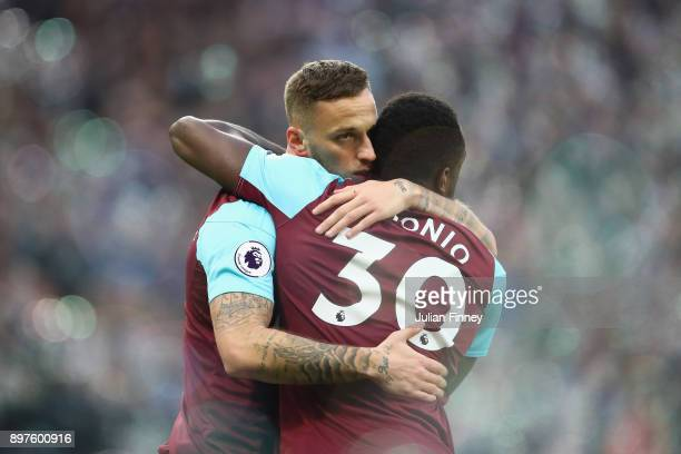 Marko Arnautovic of West Ham United celebrates with Michail Antonio after scoring his sides first goal during the Premier League match between West...