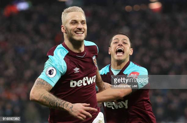 Marko Arnautovic of West Ham United celebrates with teammate Javier Hernandez after scoring his sides second goal during the Premier League match...