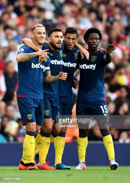 Marko Arnautovic of West Ham United celebrates with teammates after he scores his sides first goal during the Premier League match between Arsenal FC...