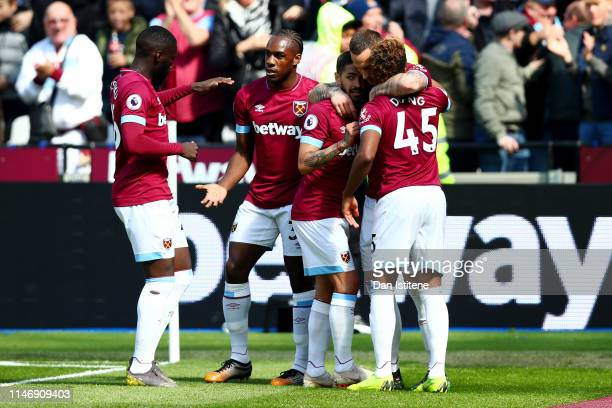 Marko Arnautovic of West Ham United celebrates with teammates after scoring his team's first goal during the Premier League match between West Ham...