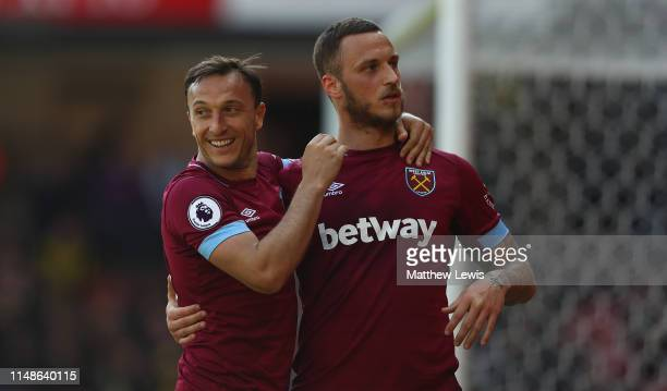 Marko Arnautovic of West Ham United congratulates Mark Noble of West Ham United on his second goal during the Premier League match between Watford FC...