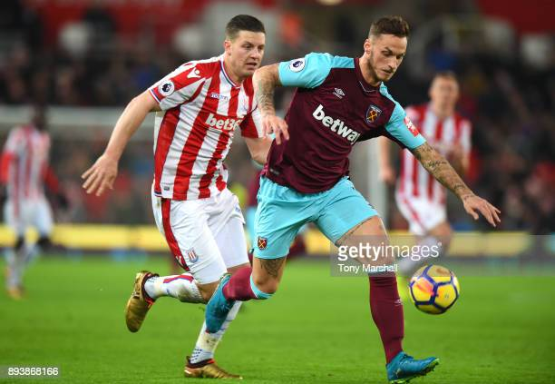 Marko Arnautovic of West Ham United gets away from Kevin Wimmer of Stoke City during the Premier League match between Stoke City and West Ham United...