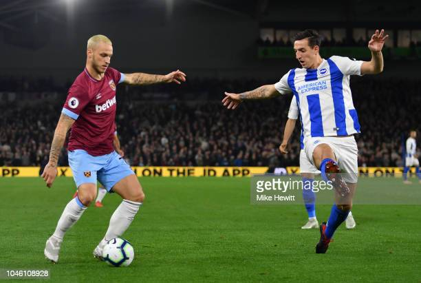Marko Arnautovic of West Ham United is challanged by Lewis Dunk of Brighton and Hove Albion during the Premier League match between Brighton Hove...