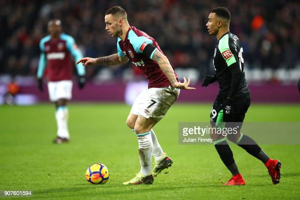 Marko Arnautovic of West Ham United is challenged by Junior Stanislas of AFC ournemouth during the Premier League match between West Ham United and...