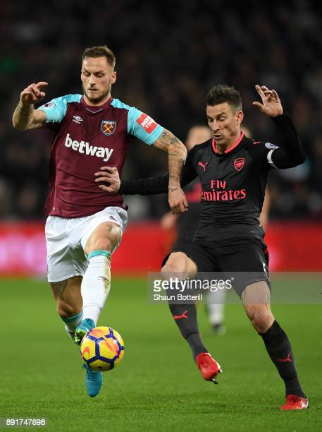Marko Arnautovic of West Ham United is challenged by Laurent Koscielny of Arsenal during the Premier League match between West Ham United and Arsenal...