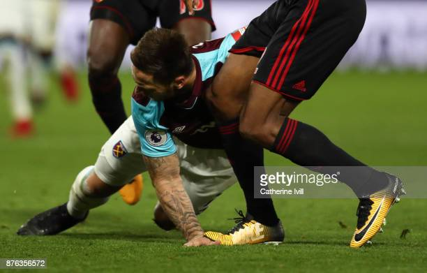 Marko Arnautovic of West Ham United is injured after Marvin Zeegelaar of Watford stands on his hand during the Premier League match between Watford...