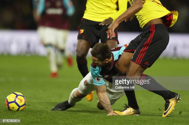 Marko Arnautovic of West Ham United is injured as Marvin Zeegelaar of Watford treads on his hand during the Premier League match between Watford and...