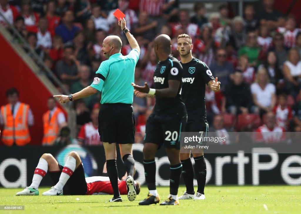 Marko Arnautovic of West Ham United is shown a red card by referee Lee Mason during the Premier League match between Southampton and West Ham United at St Mary's Stadium on August 19, 2017 in Southampton, England.