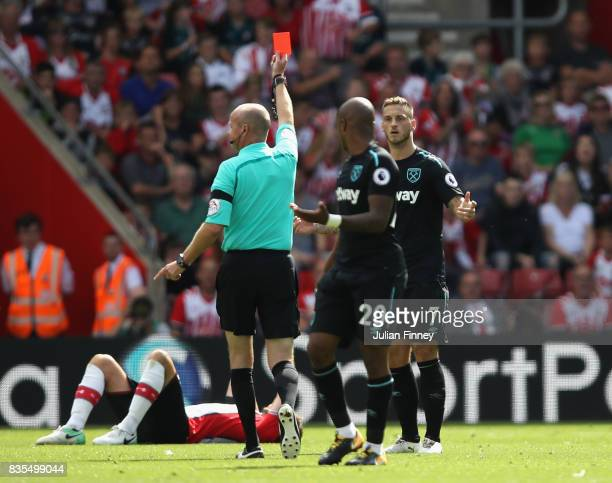 Marko Arnautovic of West Ham United is shown a red card by referee Lee Mason during the Premier League match between Southampton and West Ham United...