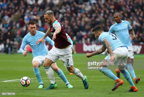 Marko Arnautovic of West Ham United is surounded as he battles with Aymeric Laporte of Manchester City during the Premier League match between West...