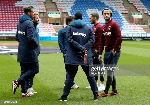 Marko Arnautovic of West Ham United looks on as players of West Ham United inspect the pitch prior to the Premier League match between Huddersfield...